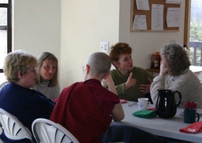 Visitors get acquainted after the noon day meal. For many it is the first stay at the Abbey.