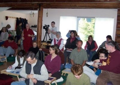 Retreatants wait in the meditation hall for Jeffrey Hopkins to arrive for teachings