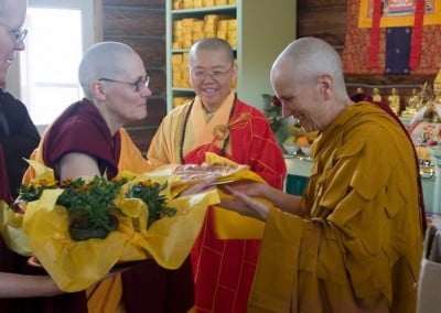 Venerable Chonyi makes an offering of a beautiful Manjushri tsa-tsa to Venerable Chodron.