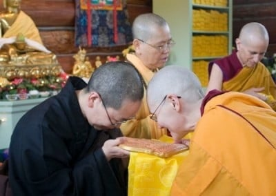 Venerable Chonyi making an offering to Venerable Jendy after the ordination ceremony.