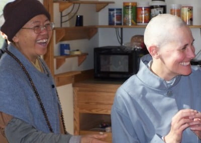 Venerable Minjia and Barbara share a happy moment before the head shaving ceremony.