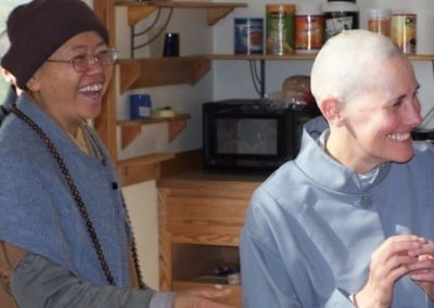 Venerable Minjia and Barbara smile and laugh at something off camera