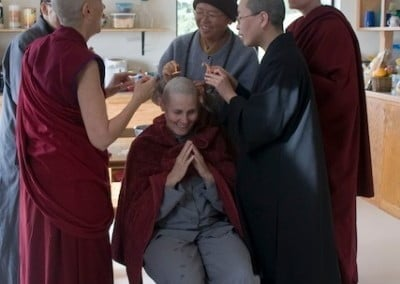 The Sangha performs the head shaving.