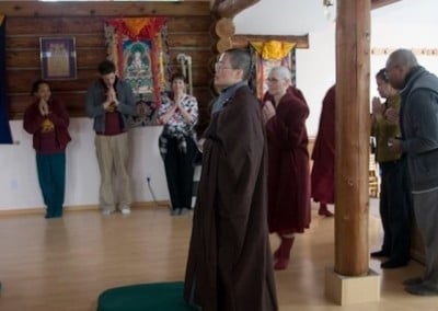 Venerable Tien Chang leads Barbara into the hall as the ceremony begins.