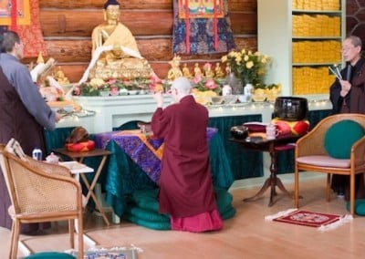 Barbara makes an incense offering to the Buddha.