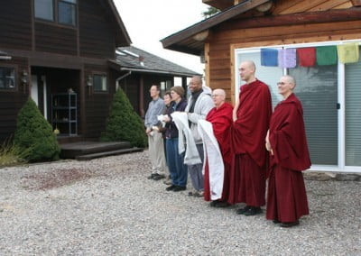 The resident community patiently awaits Geshe-la's arrival.