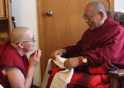 The residents take turns paying respects to Geshe-la before the teachings begin.