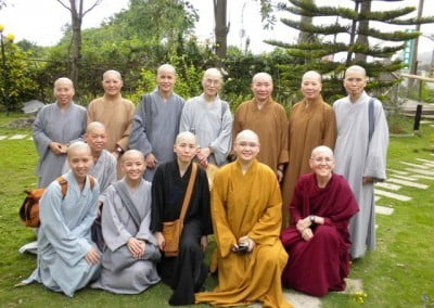 Back in her Tibetan robes, Venerable Semkye and four of her classmates (in the foreground) with the bhikshuni guides (in the background) who trained, supported, taught, and cared for the 120 nuns during the two-month program.
