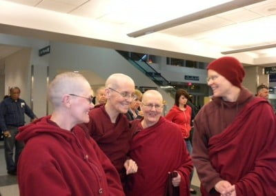 Venerable Semkye's  Sravasti Abbey Dharma sisters meet her at the airport at journey's end.