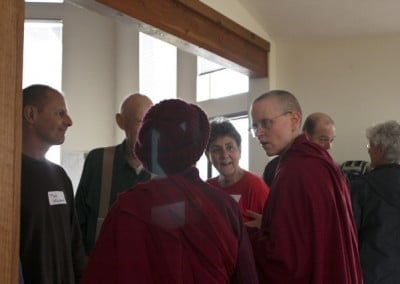 The Abbey building team – architect Tim; project managers Pat, Jo, & <br> Venerable Tarpa; and Venerable Chodron – can't resist using the occasion to chat about the Abbey's next project: Chenrezig Hall.