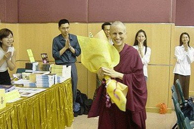 Venerable receives flowers before the start of the talk.