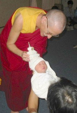 A baby blessing during the FOSA Singapore gathering