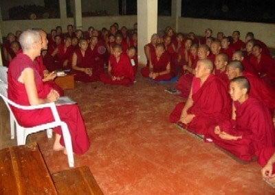 Venerable Chodron speaks to a room of monastics