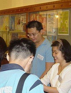 Attendees look at a table with Dharma materials