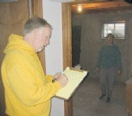 Fred and Ruth taking measurements for the basement rooms