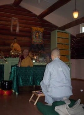 Venerable Chodron lead a beautiful ceremony in the Meditation Hall while Jan sits facing her