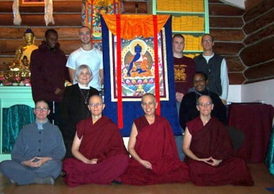 The 2007 Medicine Buddha retreatants pose with the beautiful thangka in the meditation hall.