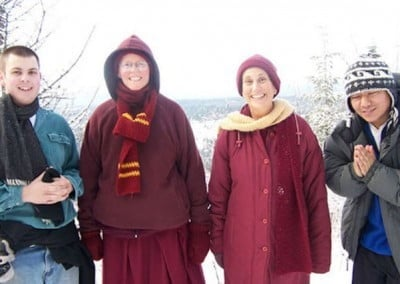 Alec, Venerable Tarpa, Venerable Chodron and Tenzin, one of our guests, pose at the high point on the Abbey land.
