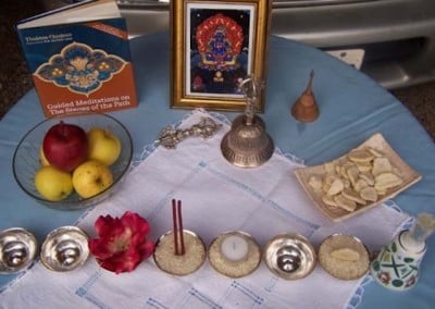 The altar is ready with offerings and a picture of Dorje Khadro, one of the Buddha's many wrathful aspects.