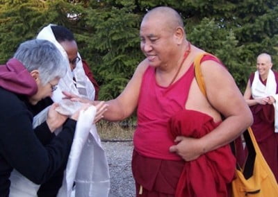 Two students offer khatas to Khensur Jampa Tegchok
