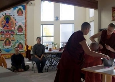 Venerable Chonyi and Venerable Tarpa work carefully as the group chants the Chenrezig mantra.