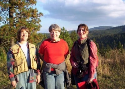 Three visitors pose for a photo outdoors