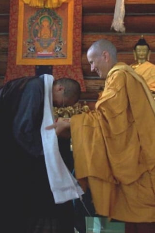 Venerable offers a gift of gratitude to Venerable Tien Chiang.