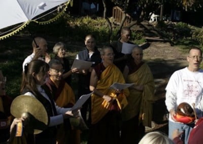 "After the King of Prayers is recited the Sravasti Abbey Monastic Corps Chorus sings the grand finale, Shantideva's A Guide to a Bodhisattva's Way of Life to the tune of the ""Star Spangled Banner."" The guests enjoy it immensely!"