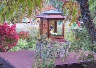 The Buddha overlooking the garden is surrounded by a glorious rainbow of fall foliage, a wonderful offering to the Buddha.