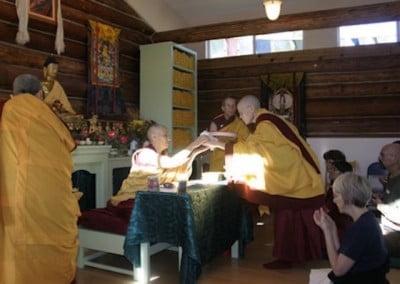 The sangha offers Venerable Chodron a mandala offering.