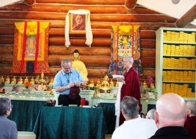 "Venerable Tarpa presents Jeffrey with an ""official"" Sravasti Abbey cap, along with other offerings, for his kindness in coming to the Abbey to teach."