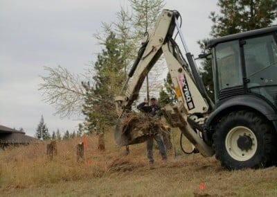 Our excavating crew from American Bay Construction moves some valuable tamarack trees before excavating the site.