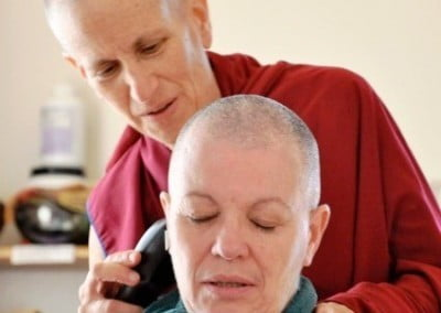 Venerable Chodron takes the honor of the first shave for Venerable Yeshe.