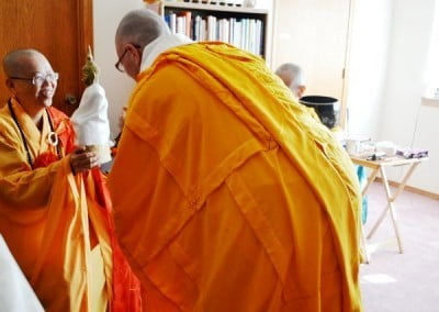 Venerable Yeshe offers a gift to her Acharya, Venerable Mingjia.