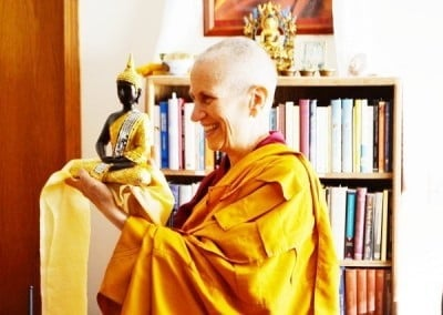 Venerable Chodron receives a beautiful Buddha from Terri.