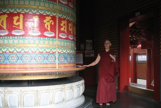 Ven. Chonyi tours the temples of Singapore. This prayer wheel is housed amidst orchid gardens on the roof of the Buddha Tooth Relic Temple.