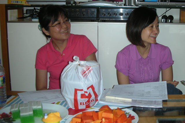 This was the first of many delicious and abundant meals offered to the monastic guests. Seow Hong and Lay-Ling joyfully finalize details of Venerable Chodron's schedule.
