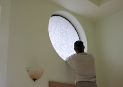 Kevin removes the trace paper template from the window opening.