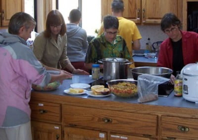 While the ceremony is proceeding, the guests and Abbey residents prepare a delicious potluck.