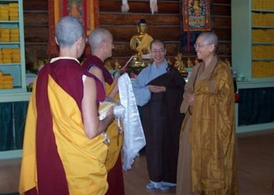 Venerable Chodron presents a gift in gratitude to the Venerables Mingjia and Jendy. The Chinese bhikshunis have been a great support to Venerable Chodron and her vision for Sravasti Abbey especially participating in the ordination ceremony which requires bhikshunis to be present.