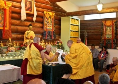 Along with a long life puja, the group offers a mandala to Venerable Chodron.