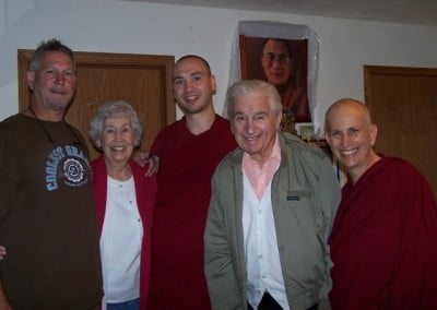 Venerable Jampel with his dad and grandmother and Venerable Chodron with her dad.