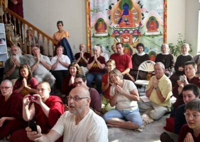 Friends chant the Buddha's name as we watch the ceremony.