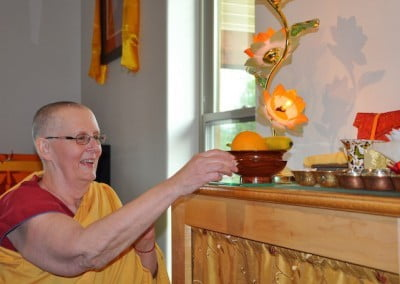 Ven. Jigme helps ready the altar for the tsog practice.