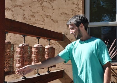 TJ sends millions of prayers out into the world with each turn of the prayer wheels.