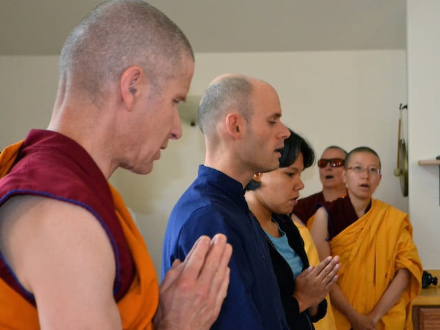 Monastics and trainees prepare for teachings.