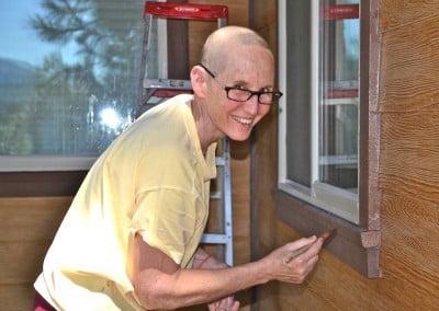 Nun painting a window