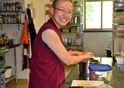 Ven. Damcho makes a meal for Ven. Chodron.