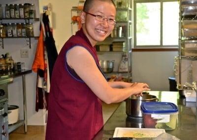 Smiling nun cooking