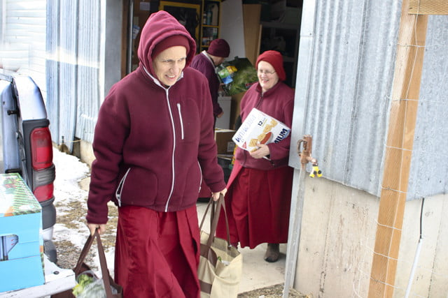 Everyone in the community participates in bringing the food into Ananda Hall.
